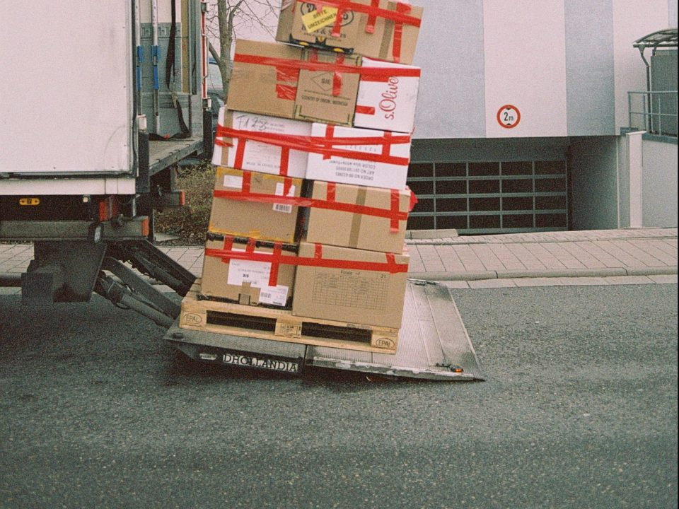 Boxes stacked on the back of a van