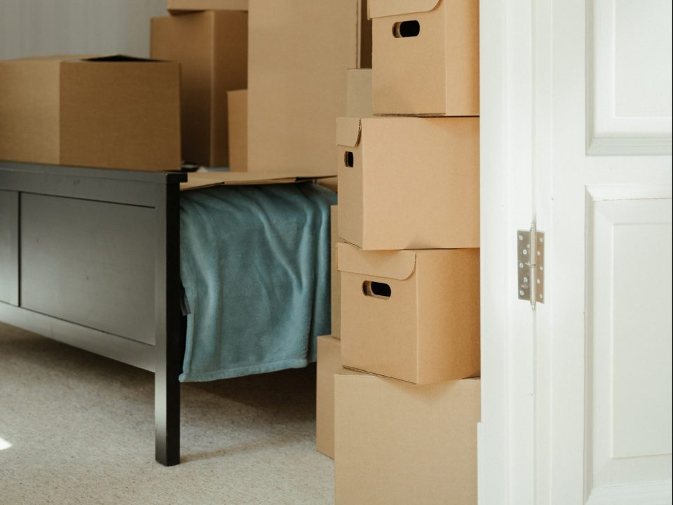 Boxes stacked on a bed